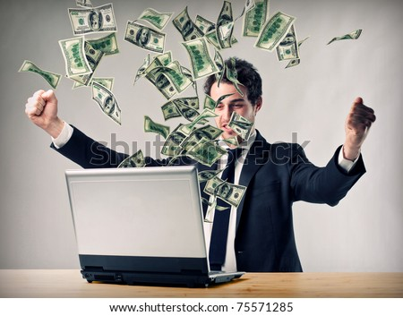 happy man with laptop and money explosion - stock photo