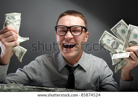 Happy man with money - stock photo