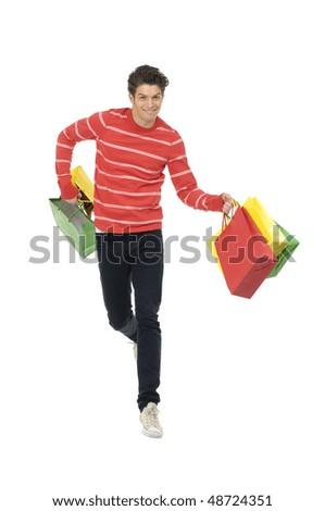 Happy man with shopping bag run - stock photo