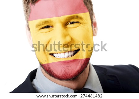 Happy man with Spain flag painted on face.