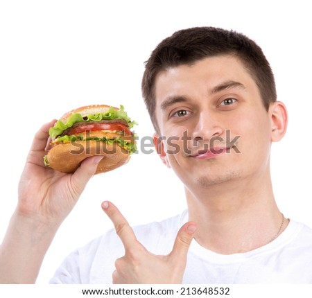 Happy man with unhealthy burger sandwich in hand get ready to eat isolated on a white background. Fast food concept - stock photo