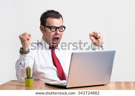 happy manager in glasses with mad crazy expression with laptop on white background
