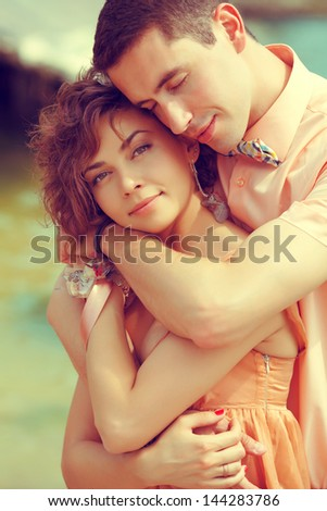 Happy marriage concept. Portrait of a beautiful couple of hipsters in trendy clothing. Wedding day. Close up. Outdoor shot - stock photo