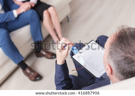 Happy marriage starting new life after therapy session - stock photo