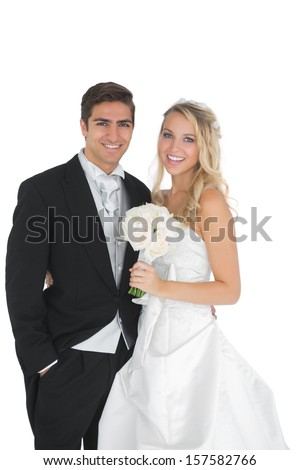 Happy married couple posing smiling at camera - stock photo