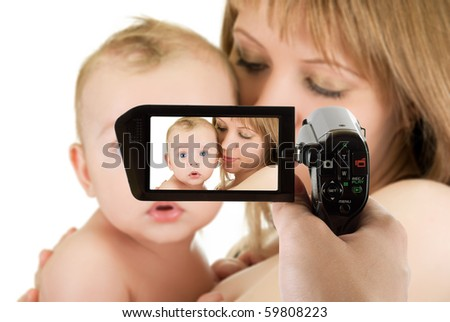 Happy maternity: mother with her baby boy isolated on a white at camcorder - stock photo