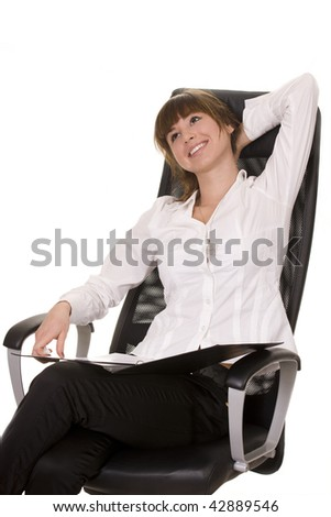 Happy mature businesswoman relaxing on chair - stock photo