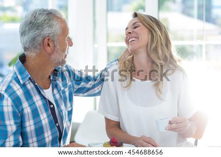 Happy mature couple having coffee in restaurant - stock photo