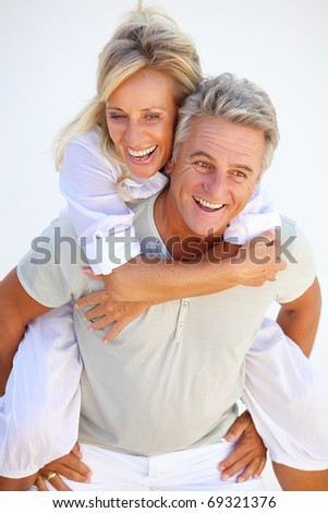 Happy mature couple having fun. - stock photo