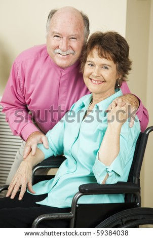 Happy mature couple in love.  The wife is in a wheelchair.