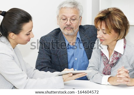 Happy mature Couple in Meeting With Financial Advisor. - stock photo
