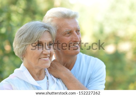 Happy mature couple in the park in the afternoon