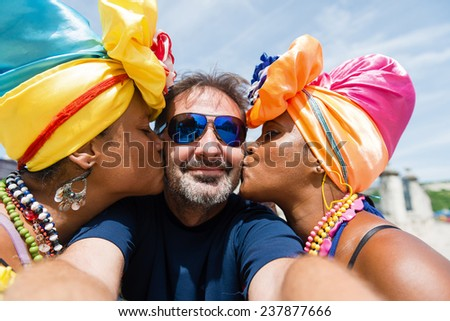 Happy,mature man between attractive Cuban women, selfie, self portrait photo.Havana, Cuba - stock photo