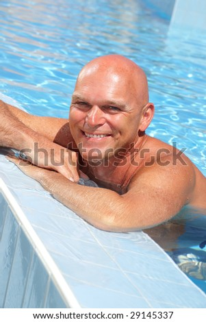 happy mature man in the swimming pool - stock photo