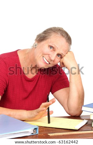 Happy mature woman with writing pad