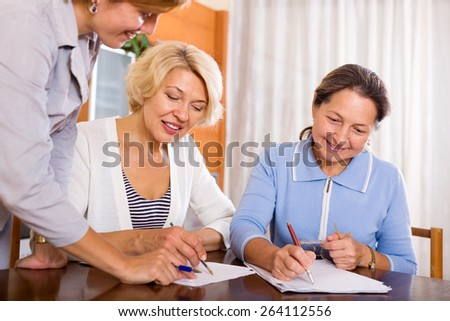 Happy mature women consulting at insurance agent office