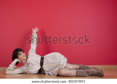 happy mature women laying down in the floor of his new house - stock photo