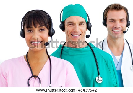 Happy medical team using headsets against a white background