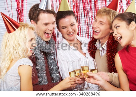 Happy men and women toasting with champagne on birthday party - stock photo
