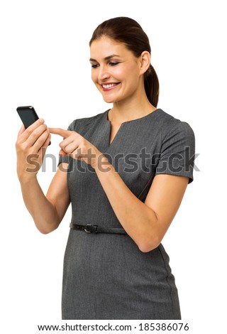 Happy mid adult businesswoman touching smart phone isolated over white background. Vertical shot.