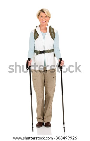 happy mid age female hiker standing on white background