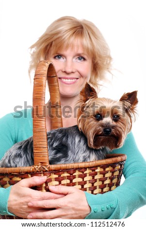 Happy mid age woman ang her yorkshire terrier over white background