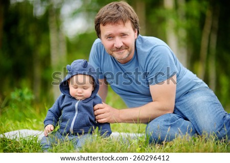 Happy middle age man with his little baby  - stock photo