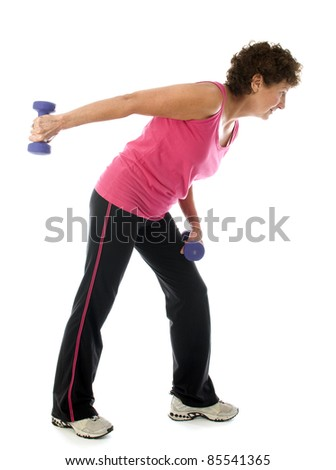 happy middle age senior woman exercising with dumbbells doing triceps shoulder raise