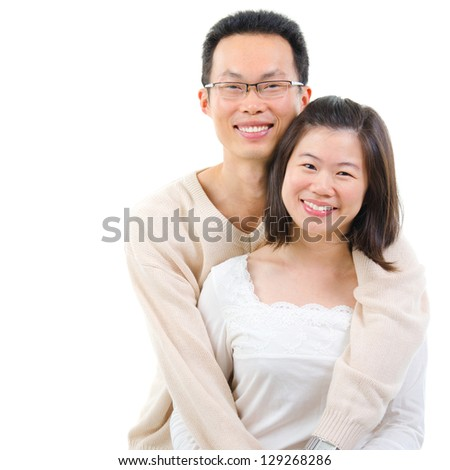 Happy middle aged Asian couple in love. Asian couple smiling isolated on white background. - stock photo