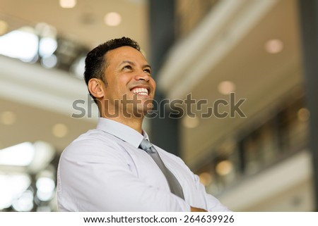 happy middle aged business man in modern office - stock photo