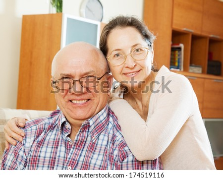 Happy middle-aged couple in glasses - stock photo