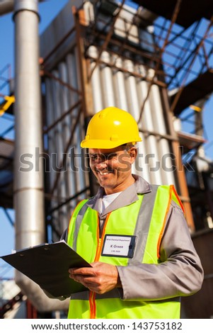 happy middle aged heavy industry worker working in plant - stock photo