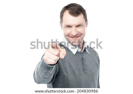 Happy middle aged man pointing at camera - stock photo