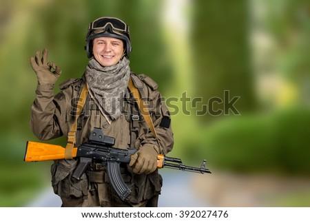 Happy military man gesturing OK sign - stock photo