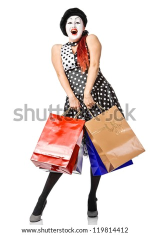 Happy mime in spotty dress holding shopping bags. Isolated - stock photo