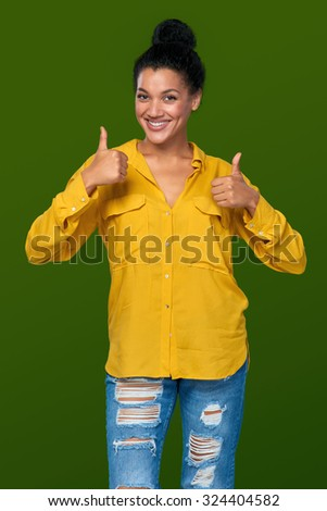 Happy mixed race african american - caucasian woman giving you double thumb up - stock photo