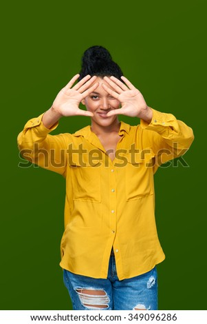 Happy mixed race african american - caucasian woman showing two palms, giving high five gesture - success and winning concept. - stock photo