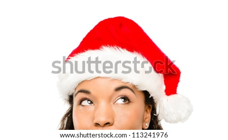 Happy mixed race businesswoman wearing Christmas hat isolated on