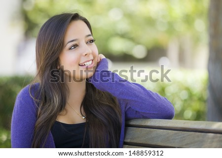 Happy Mixed Race Female Student Portrait on School Campus Bench. - stock photo