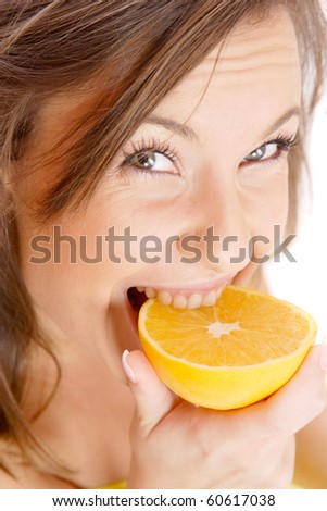 happy model eating an orange over white background