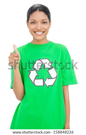Happy model wearing recycling tshirt giving thumb up on white background - stock photo