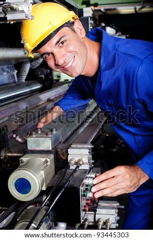 happy modern industrial machine operator at work - stock photo