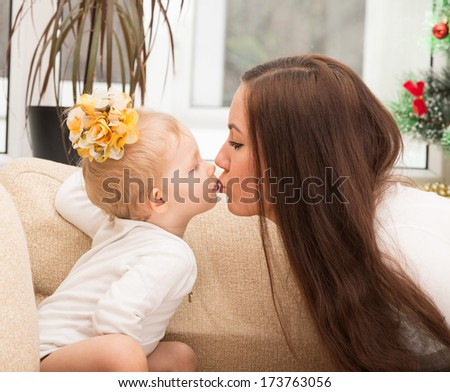 Happy mom and child girl hugging and kissing isolate on white background. The concept of cheerful childhood and family. Beautiful Mother and her baby - stock photo