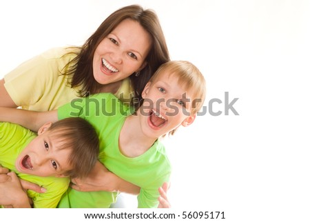 happy mom and children on a white background - stock photo