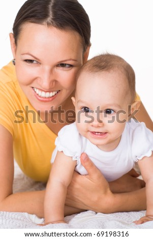 happy mom holds  baby on a white