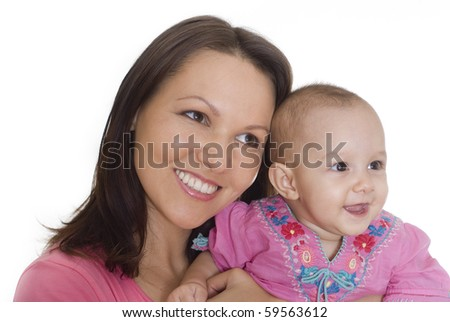 happy mom stands and holds the baby