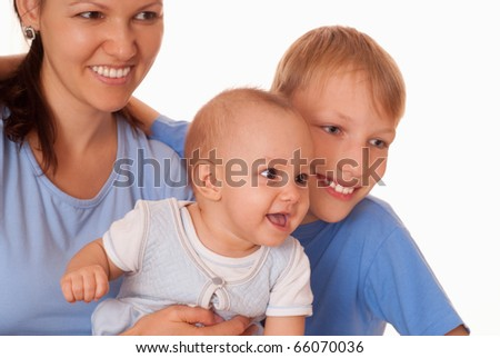 happy mom with her children on a light background