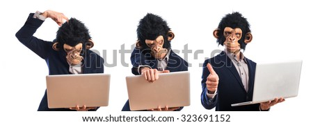Happy monkey man holding a laptop