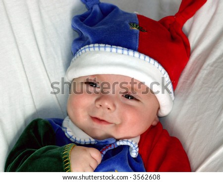 Happy 6-month old Baby in his Christmas pajamas - stock photo
