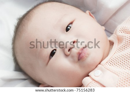 Happy 6 months old Asian baby boy - stock photo